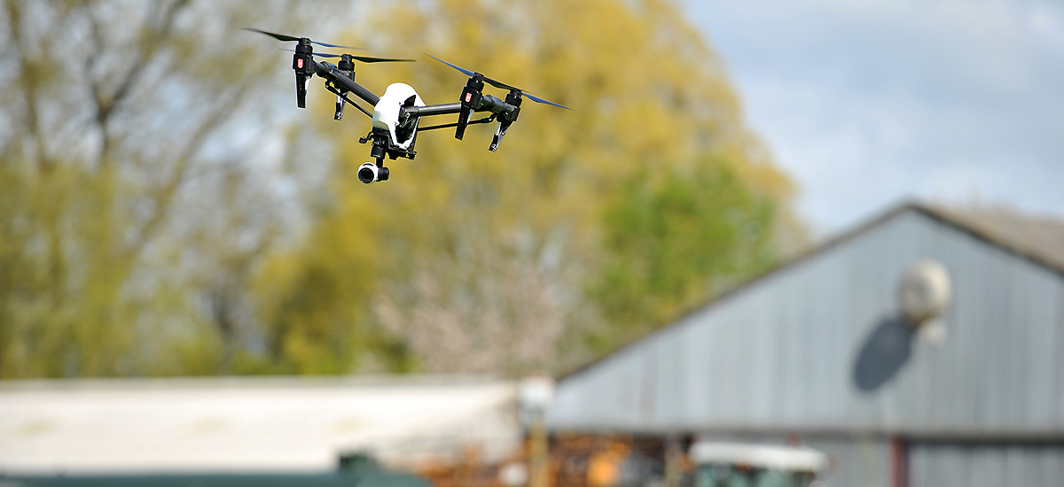 Image showing a drone flying over a farm