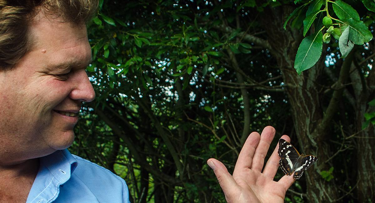 Charlie Burrell holding a butterfly