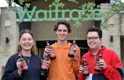 Student members of the Muddy Wellies social enterprise group (left to right) at Waitrose in Cirencester: Amelia Bailey, Charles de Fierlant Dormer and Ben Middlewood.