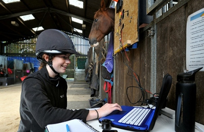 Rider working in stables